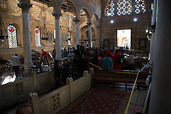 December 11, 2016 - Cairo, Egypt - Egyptian security forces and members of the clergy inspect the scene of a bomb explosion at the Saint Peter and Saint Paul Coptic Orthodox Church on December 11, 2016, in Cairo's Abbasiya neighbourhood. The blast killed at least 25 worshippers during Sunday mass inside the Cairo church near the seat of the Coptic pope who heads Egypt's Christian minority, state media said. (Credit Image: © Fayed El-Geziry/NurPhoto via ZUMA Press)