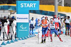 CHOI Bogue KOR B3 Guide: KIM Hyunwoo competing in the ParaBiathlon, Para Biathlon at  the PyeongChang2018 Winter Paralympic Games, South Korea.