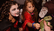 Tierney (left) and Makaya Smith of Fairborn get up close and personal with Jade during Howl-O-Ween 2010 at the Boonshoft Museum of Discovery in Dayton, Saturday, October 23, 2010..