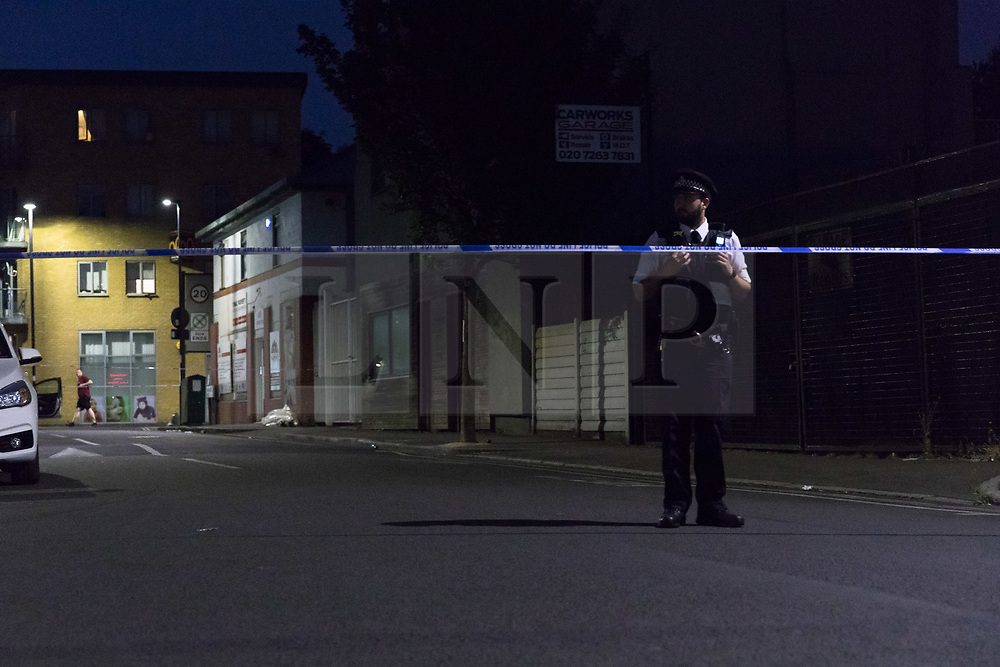 © Licensed to London News Pictures. 01/07/2018. London, UK. The crime scene in Fairbridge Road in Islington, north London this evening. Police were called to Fairbridge Road at 18:50 tonight where a 14 year old boy was found suffering from stab wounds. An 11 year old by has been arrested on suspicion of attempted murder.  Photo credit: Vickie Flores/LNP