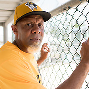 Guayama, Puerto Rico - July 6, 2018: Carlos Texidor, manager, stands in a dugout. He leads the 12 and Under selection from Guayama which will compete in Little League World Series.<br /> (Angel Valentin for ESPN)