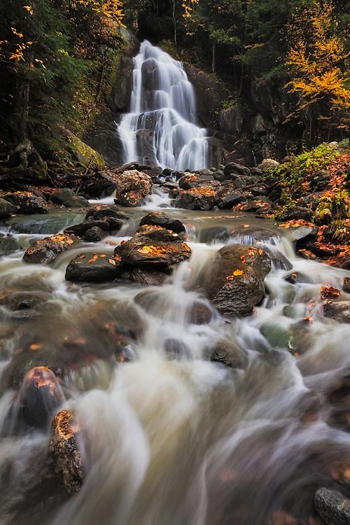 Peak color graces the banks and boulders, Moss Glen Falls, Granville Gulf, Vermont
