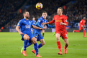 Leicester City forward Jamie Vardy (9) keeps an eye on the ball with Leicester City midfielder Danny Drinkwater (4) about to battle with Liverpool midfielder Lucas Leiva (21) during the Premier League match between Leicester City and Liverpool at the King Power Stadium, Leicester, England on 27 February 2017. Photo by Jon Hobley.