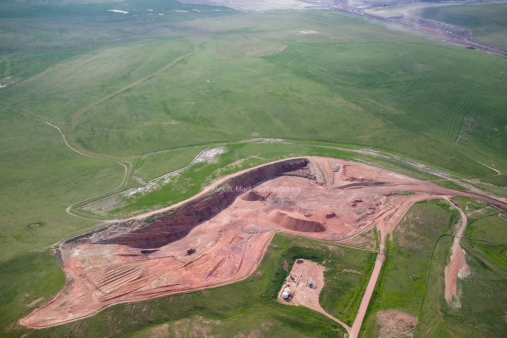 "Coal strip mining in the Powder River Basin. The Powder River Basin coal beds are shaped like elongated bowls and as mines expand from east to west in the Powder River Basin, they will be going ""down the sides of the bowl"" in order to extract the coal."