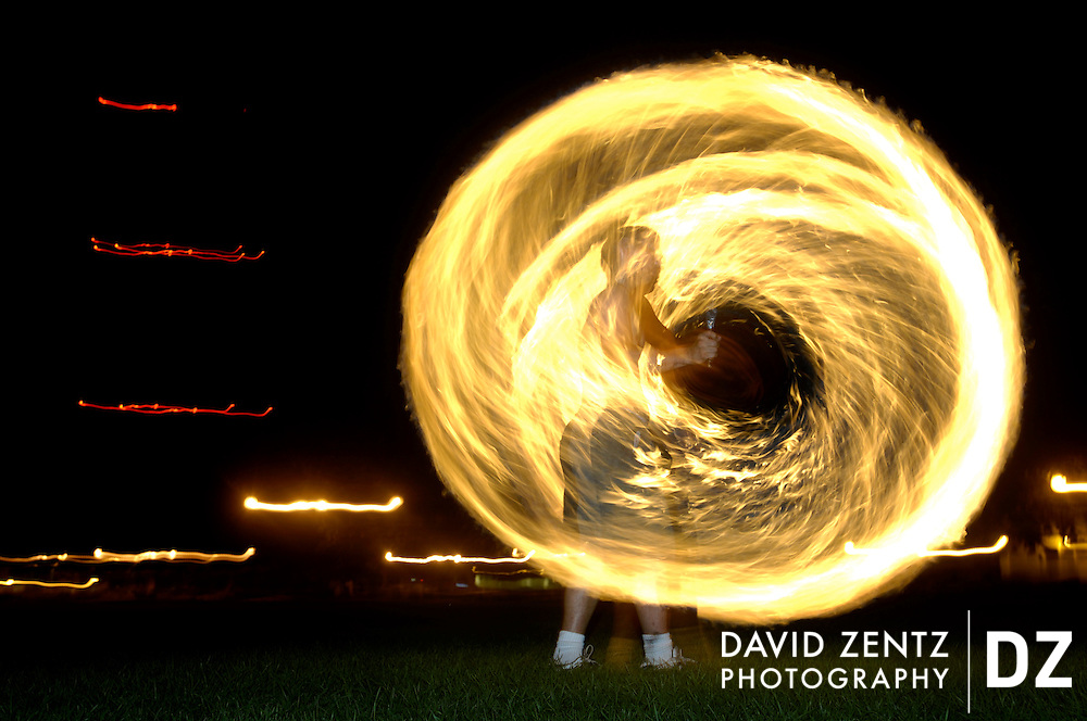 PURCHASE THESE PHOTOS AT PJSTAR.COM DAVID ZENTZ/JOURNAL STAR.David Van Roeyen, 23, spins fire using a Chinese straight sword while practicing with the group Pheonix Rising at Olin Quad on the Bradley campus in August.