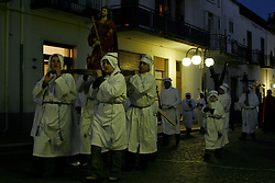 """Calitri (AV) Italy - 14/04/2006 -  In Calitri, the most important celebration of Good Friday is organized by the Fraternity of the Immaculate Conception. ``The Procession of the Mystery'' is a colourful and moving ritual in which fraternity brothers or """"fratelli"""" don in white capes and hoods and wear crowns of thorns on their heads. They walk sombrely to the Sanctuary of Santa Lucia in the nearby Mount Calvery, followed by the town faithful."""