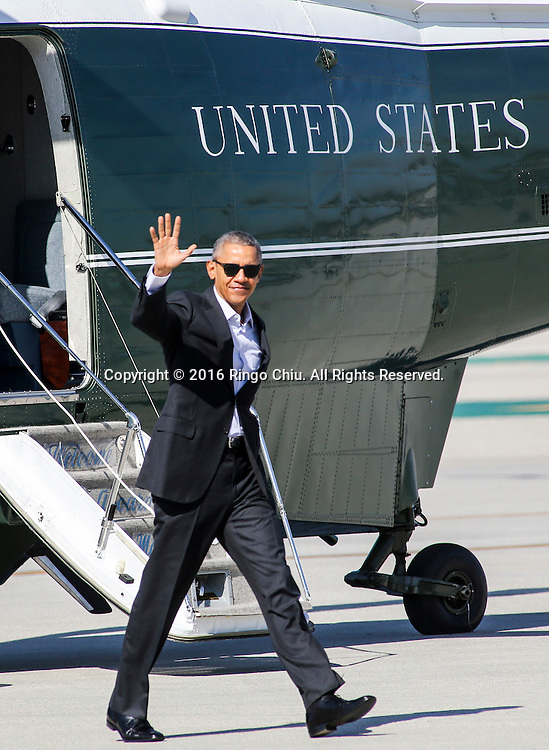 President Barack Obama waves as he walks from Marine One to Air Force One at Los Angeles International Airport in Los Angeles, Friday, Feb 12, 2016, en route to Palm Springs in advance of a summit of Asian leaders on Monday and Tuesday, which the president will host at Sunnylands resort in Rancho Mirage. Obama will be joined by Secretary of State John Kerry at Sunnylands for the gathering of leaders from the Association of Southeast Asian Nations. The summit is aimed at strengthening the new U.S.-ASEAN strategic partnership, forged last November during a presidential trip to Malaysia. (Photo by Ringo Chiu/PHOTOFORMULA.com)<br /> <br /> Usage Notes: This content is intended for editorial use only. For other uses, additional clearances may be required.
