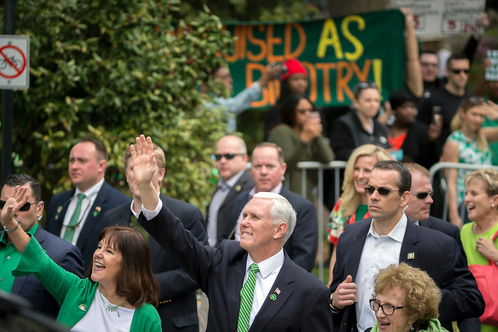 Vice President Mike Pence, center, waves to supporters as he marches in the St. Patrick's Day parade Saturday, March 17, 2018, in Savannah, Ga. (AP Photo/Stephen B. Morton)