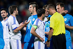 Sokratis Papastathopoulos of Greece talks to Bostjan Cesar of Slovenia during friendly football match between national teams of Slovenia and Greece, on May 26, 2012 in Kufstein, Austria.   (Photo by Vid Ponikvar / Sportida.com)