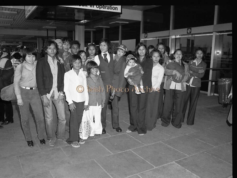 Vietnamese Refugees Arrive In Dublin  (N66)..1981..18.03.1981..03.18.1981..18th March 1981..As part of a resettlement plan initiated by the United nations, Ireland agreed to accept into the country a number of Vietnamese families displaced by the Vietnam war...Image shows the arrival of the 17 displaced Vietnamese people who hoped to settle in Ireland as part of a United Nations incentive.