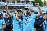 Chris Woakes of England and Liam Plunkett of England celebrating winning the Cricket World Cup on the lap of honour during the ICC Cricket World Cup 2019 Final match between New Zealand and England at Lord's Cricket Ground, St John's Wood, United Kingdom on 14 July 2019.