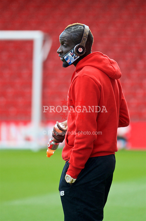 BOURNEMOUTH, ENGLAND - Sunday, April 17, 2016: Liverpool's Mamadou Sakho on his phone on the pitch before the FA Premier League match against AFC Bournemouth at Dean Court. (Pic by David Rawcliffe/Propaganda)