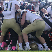 Salesianum running back Colby Reeder (28) strip the ball from the hands of William Penn quarterback Johnson (12) and return the fumble 30 yards for a touchdown for a 14-0 lead during a regular season football game between No. 2 Salesianum and No.1 William Penn Saturday, Oct. 31, 2015 at William Penn High School in New Castle.