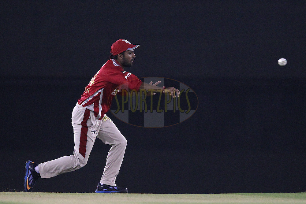 Manan VOHRA of the Kings XI Punjab throws the ball in during match 2 of the Oppo Champions League Twenty20 between the Kings XI Punjab and the Hobart Hurricanes held at the Punjab Cricket Association Stadium, Mohali, India on the 18th September 2014<br /> <br /> Photo by:  Ron Gaunt / Sportzpics/ CLT20<br /> <br /> <br /> Image use is subject to the terms and conditions as laid out by the BCCI/ CLT20.  The terms and conditions can be downloaded here:<br /> <br /> http://sportzpics.photoshelter.com/gallery/CLT20-Image-Terms-and-Conditions-2014/G0000IfNJn535VPU/C0000QhhKadWcjYs