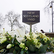 Flower tributes at New Scotland Yard for the victims of the Tuesday's 21th March 2017 attack on Westminster Bridge and in the grounds of Parliament, in London, Friday, March 24, 2017. by See Li