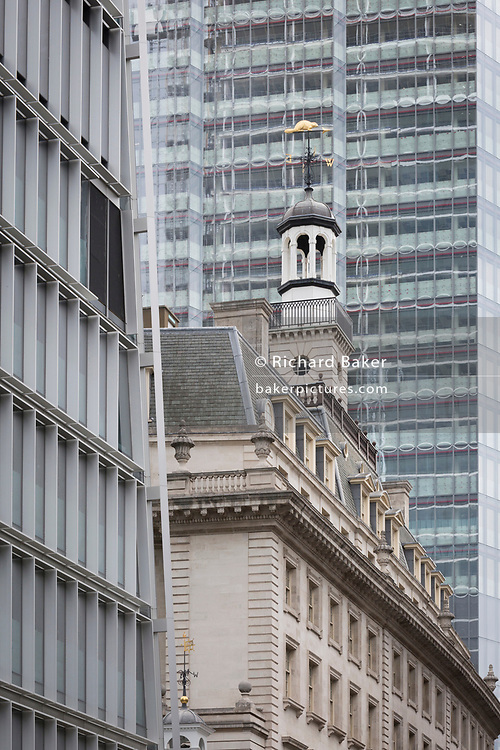 Old and new architecture on Bishopsgate in the City of London - the capital's financial district - on 20th August 2018, in London, England.