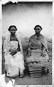 Two Nubian women wear traditional dress with nose rings, bracelets and necklaces.  (circa 1930s)