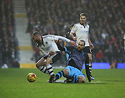 Fulham defender Ashley (Jazz) Richards just beating Sheffield Wednesday striker Atdhe Nuhiu to the ball during the Sky Bet Championship match between Fulham and Sheffield Wednesday at Craven Cottage, London, England on 2 January 2016. Photo by Matthew Redman.
