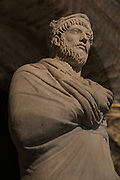 Roman marble statue of an unknown priest, long thought to represent the Roman emperor Julian the Apostate, 4th century AD, in the Musee de Cluny or the Musee National du Moyen Age, Paris, France. The statue was found in Paris in the 19th century and acquired by the museum in 1859. Picture by Manuel Cohen