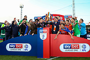 Luton celebrate winning and Luton Town interim manager Mick Harford lifts the trophy the EFL Sky Bet League 1 match between Luton Town and Oxford United at Kenilworth Road, Luton, England on 4 May 2019.