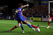 AFC Wimbledon defender Toby Sibbick (20) with a shot on goal during the EFL Sky Bet League 1 match between AFC Wimbledon and Walsall at the Cherry Red Records Stadium, Kingston, England on 21 August 2018.