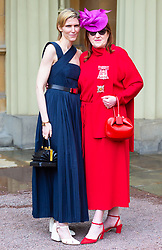 Harpers Bazaar Editor in Chief Glenda Bailey, right, with 'best friend' Gabriela Hearst, was invested as a Dame for services to the GREAT Britain campaign and UK prosperity, charity, fashion and journalism at an investiture ceremony conducted by Prince William, Duke of Cambridge at Buckingham Palace. Hat by Philip Tracey, Dress by Valentino, bag by Gabriela Hearst, shoes by Jimmy Choo. London, May 09 2019.