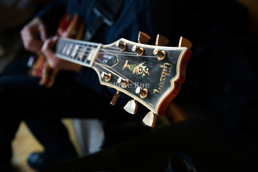 musician playing a Gibson custom electric guitar