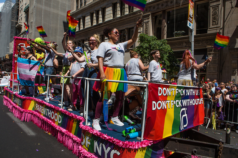 "New York, NY - 30 June 2019. The New York City Heritage of Pride March filled Fifth Avenue for hours with participants from the LGBTQ community and it's supporters. A float from the women's healthcare provider Planned Parenthood, with a banner reading ""Don't f*ck with us / don't f*ck wthout us."""