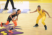 Connecticut Sun guard Jasmine Thomas (5) dribbles up court as Los Angeles Sparks guard Tierra Ruffin-Pratt (10) defends during a WNBA basketball game, Friday, May 31, 2019, in Los Angeles.The Sparks defeated the Sun 77-70.  (Dylan Stewart/Image of Sport)