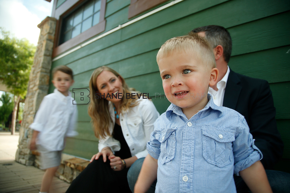 5/28/15 5:35:03 PM -- Miracle Miles and his family pose for portraits and play at the QuikTrip park for the 2015 Saint Francis Health System advertising campaign. <br /> <br /> Photo by Shane Bevel