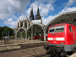Cologne Hauptbahnhof or main railway station with historic Cathedral or Dom to rear Germany