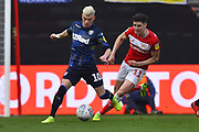 Ezgjan Alioski (10) of Leeds United brings the ball out as he is chased by Callum O'Dowda (11) of Bristol City during the EFL Sky Bet Championship match between Bristol City and Leeds United at Ashton Gate, Bristol, England on 9 March 2019.