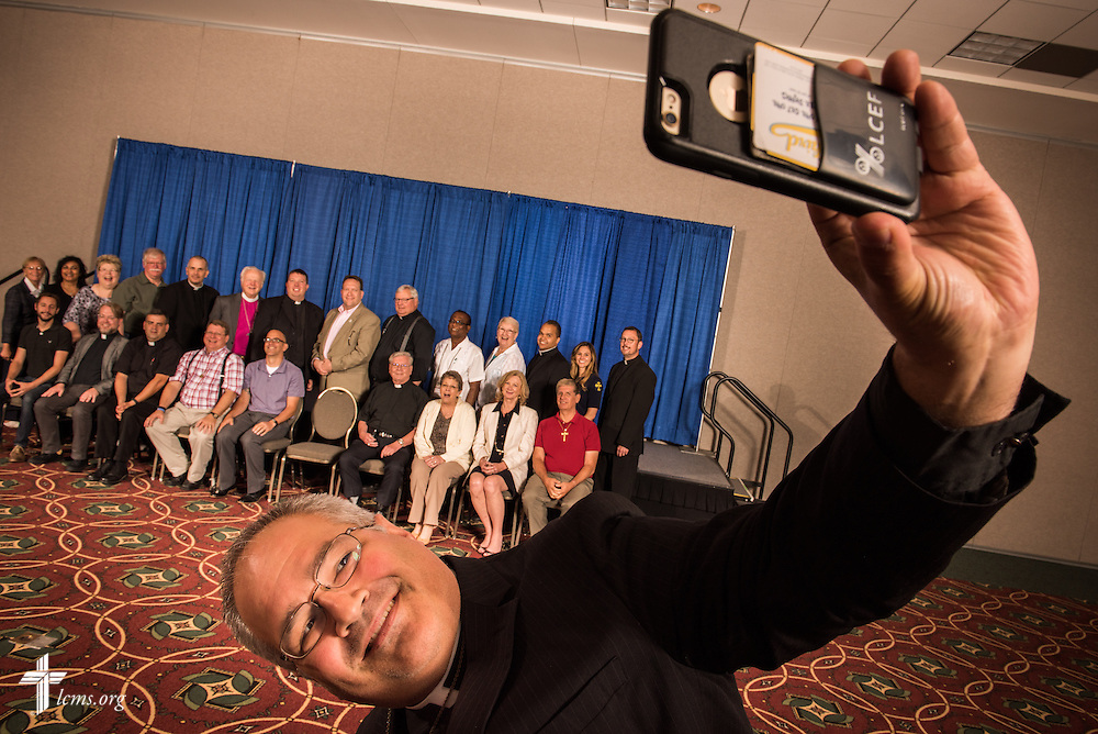 The Rev. Derek G. Lecakes, president of the LCMS Atlantic District, takes a selfie during a district group photograph on Wednesday, July 13, 2016, at the 66th Regular Convention of The Lutheran Church–Missouri Synod, in Milwaukee. LCMS/Erik M. Lunsford