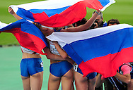 Russia's Tatyana Firova, Kseniya Ustalova and Antonina Krivoshapka pose for photographers after winning the first three places in the women's 400m final at the 2010 European Athletics Championships at the Olympic Stadium in Barcelona on July 30, 2010