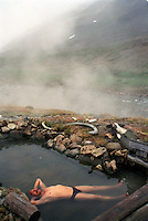 039078.AA.0820.warming13.kc--Bering Sea, Off Providenya, Russia--A steam bath is enjoyed by one of the locals. The naturally occuring hot spring is located near the cabin. The story deals with the enviromental issue of global warming throughout the region of Russia directly across the Bering Sea from Nome, Alaska. The story touches on the people their way of living, the rough economy and the extent they are effected by the slowly warming temperature as documented by scientists.  More Details To Come.