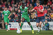 Ntumba Massanka (on loan from Burnley) (Wrexham AFC) runs with the ball getting past Shaun Rooney (York City) during the Vanarama National League match between York City and Wrexham FC at Bootham Crescent, York, England on 17 April 2017. Photo by Mark P Doherty.