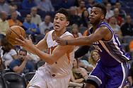 Mar 15, 2017; Phoenix, AZ, USA; Phoenix Suns guard Devin Booker (1) drives the ball against Sacramento Kings guard Buddy Hield (24) in the first half at Talking Stick Resort Arena. Mandatory Credit: Jennifer Stewart-USA TODAY Sports