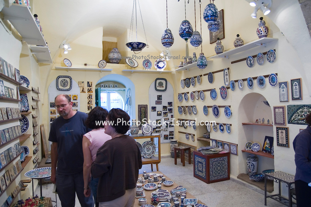 Israel, Jerusalem the old city, the Armenian quarters, tourists inside a souvenir shop of hand made pottery and tiles