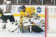 Vermont goalie Stepanos Lekkas (40) makes a save on a shot by Quinnipiac's Tim Clifton (11) during the men's hockey game between the Vermont Catamounts and the Quinnipiac Bobcats in the championship game of the Friendship Four hockey tournament at the SSE Arena on Saturday evening November 26, 2016 in Belfast, Ireland. (BRIAN JENKINS/for the FREE PRESS)