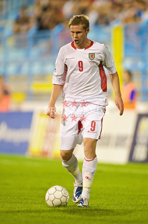 PODGORICA, MONTENEGRO - Wednesday, August 12, 2009: Wales' Simon Church in action against Montenegro during an international friendly match at the Gradski Stadion. (Photo by David Rawcliffe/Propaganda)