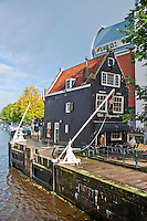 Amsterdam, Holland. The Old Fluyswacht Tavern on the canalside.