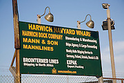 Sign at Harwich Navyard Wharf for different services and shipping lines, Harwich, Essex, England