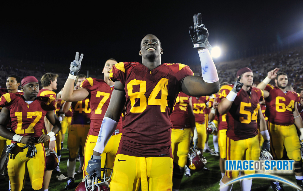 "Nov 1, 2008; Los Angeles, CA, USA; Southern California Trojans defensive end Kyle Moore (84) flashes a ""Fight On"" sign in celebration after 56-0 victory over the Washington Huskies at the Los Angeles Memorial Coliseum."