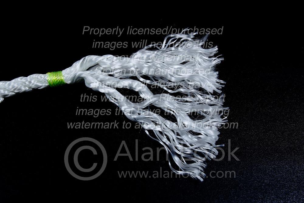 Rope:  frayed end of white nylon rope