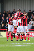Shaun Miller celebrates after he gets his brace and puts  Morecambe in the lead during the Sky Bet League 2 match between AFC Wimbledon and Morecambe at the Cherry Red Records Stadium, Kingston, England on 17 October 2015. Photo by Stuart Butcher.