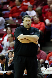 09 January 2010: Evansville coach Marty Simmons studies the action on the floor. The Purple Aces of Evansville play the Redbirds of Illinois State on Doug Collins Court inside Redbird Arena at Normal Illinois.