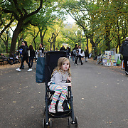 NEW YORK, NEW YORK - NOVEMBER 4: A portrait of a three year old girl in a push chair in a fall scene in Central Park, Manhattan, New York.  4th November 2017. (Photo by Tim Clayton/Corbis via Getty Images)