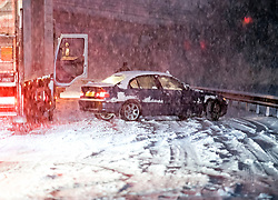 © Licensed to London News Pictures. 10/12/2017. Bourne End, UK. A car which has spun on the road in heavy snowfall on the A41 near Bourne End in Buckinghamshire as parts of the south east of England are blanketed with snow for the first time this winter. Photo credit: Ben Cawthra/LNP