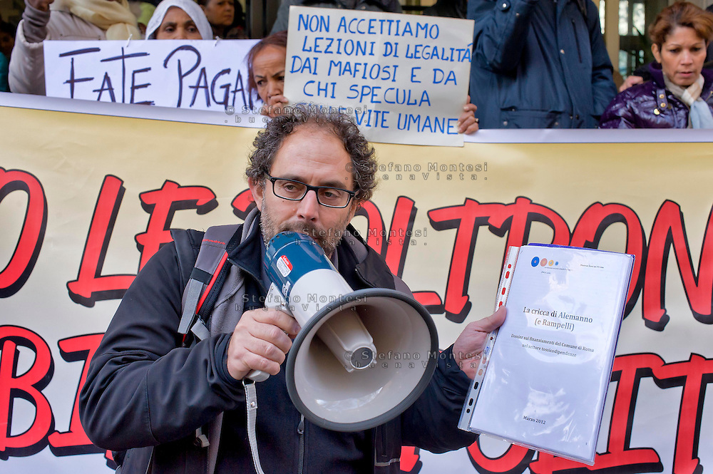 "Roma, 09 Dicembre 2004<br /> Mafia Capitale: occupato l'assessorato alle Politiche Sociali di Roma Capitale da Action diritti in movimento, per denunciare l'incapacità dell'assessorato nella gestione del sociale e per il profitto e la speculazione su chi vive un disagio economico e sociale come riportato dall'inchiesta e dagli arresti della magistratura nell'operazione ""Mondo di Mezzo"". Carlo De Angelis, Social Pride, con il megafono <br /> Rome, December 9, 2004<br /> Mafia Capital: occupied the Department of Social Policies of Roma Capitale by Action rights in movement, to denounce  the inability the Councillor in the management of social and for profit and speculation about who lives an economic and social hardship as reported by investigation and arrests in the operation of the judiciary ""Middle World"". Carlo De Angelis, Social Pride, with megaphone."