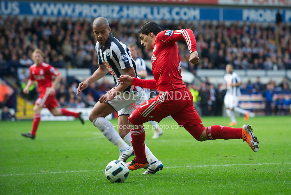 WEST BROMWICH, ENGLAND - Saturday, April 2, 2011:  Liverpool's Luis Alberto Suarez Diaz in action against West Bromwich Albion during the Premiership match at The Hawthorns. (Photo by Dave Kendall/Propaganda)
